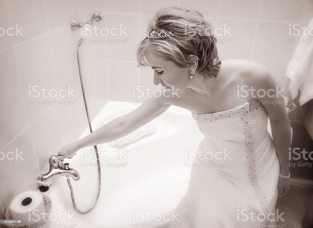 Beautiful bride getting a bath ready royalty-free stock photo