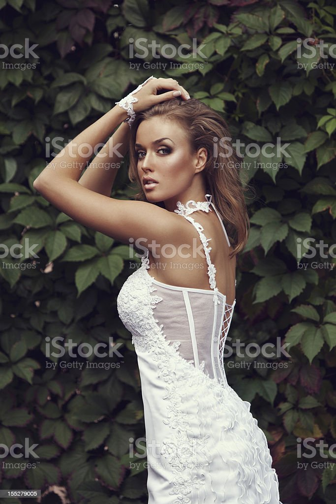 Beautiful bride holding a bouquet of flowers royalty-free stock photo