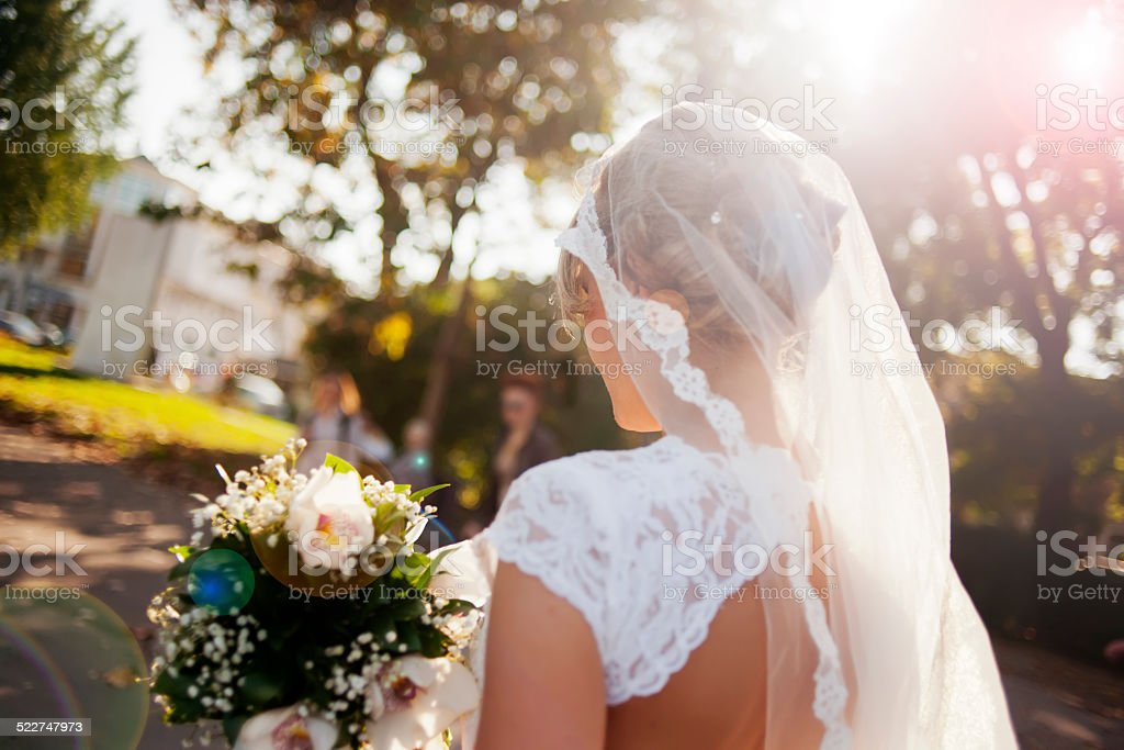 Beautiful bride holding flower bouquet stock photo