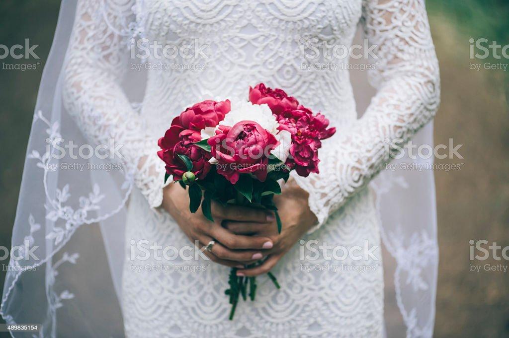 Beautiful bride in a white dress stock photo