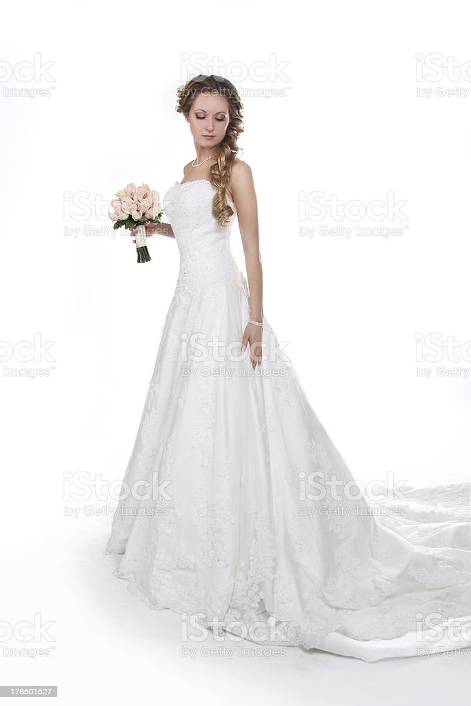 Beautiful bride in luxurious wedding dress isolated on white royalty-free stock photo