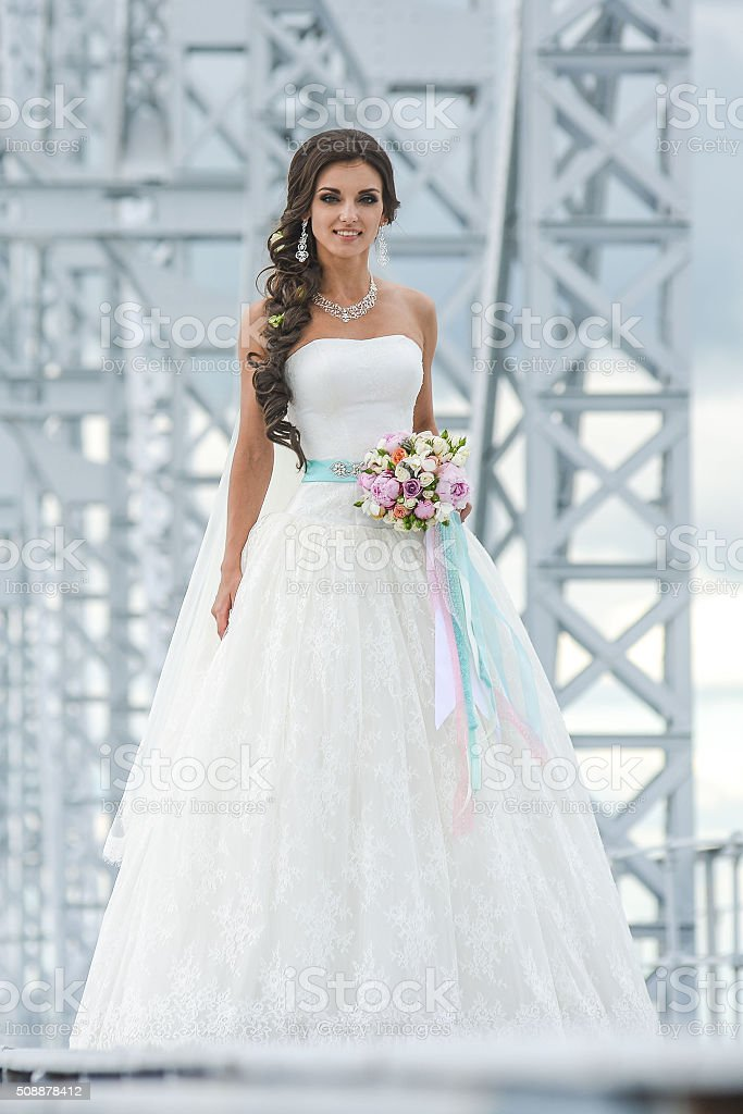 beautiful bride is standing stock photo