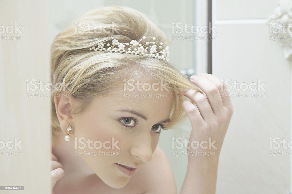 Beautiful bride looking in mirror royalty-free stock photo