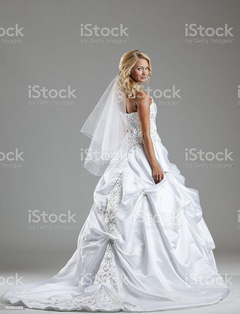 Beautiful bride on gray background stock photo