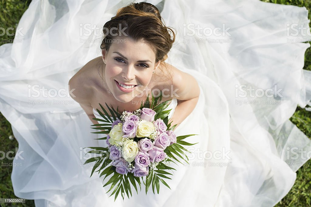A beautiful bride on her wedding day with bright flowers stock photo