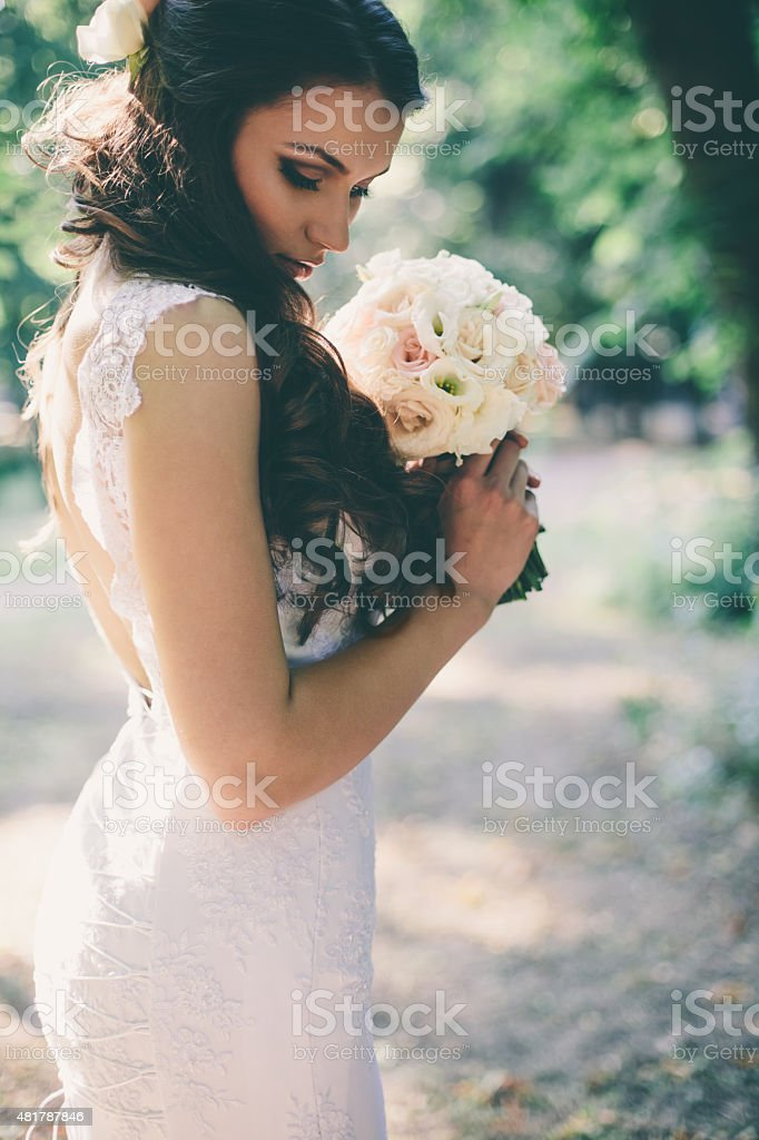 Beautiful bride outdoors stock photo