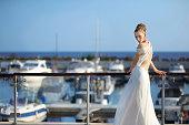 Beautiful bride posing in a harbor