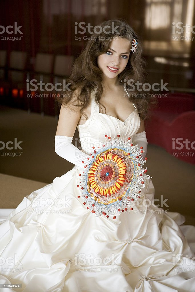 Beautiful bride sitting in the restaurant. royalty-free stock photo