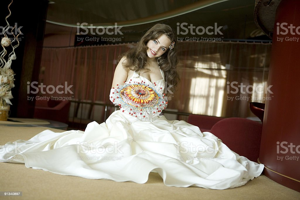 Beautiful bride sitting on the floor. royalty-free stock photo