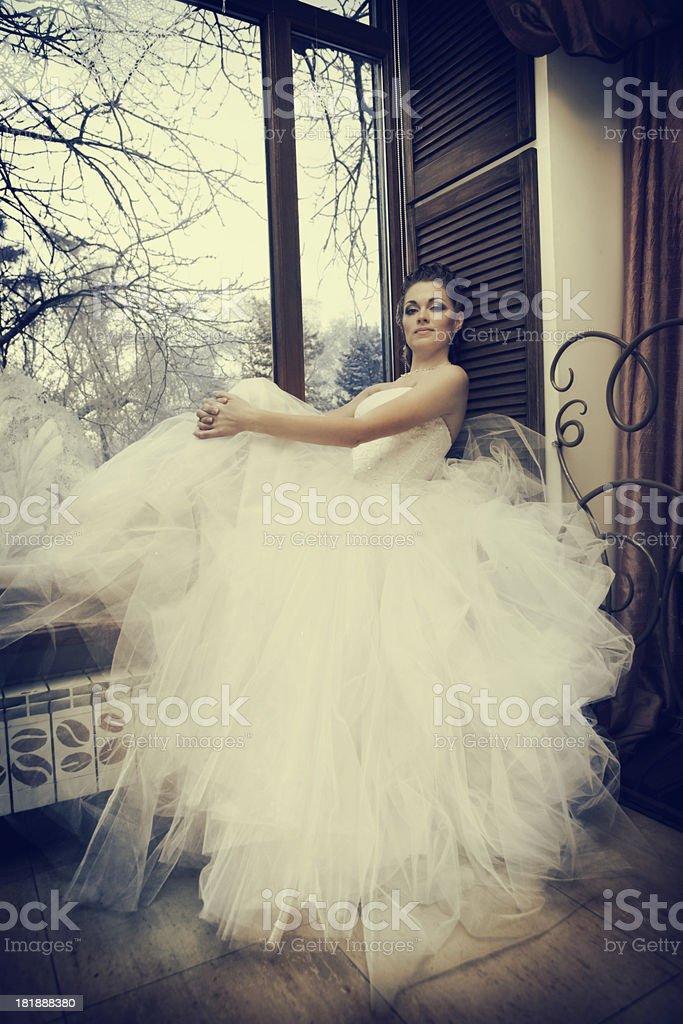 Beautiful Bride  Sitting on the Window royalty-free stock photo
