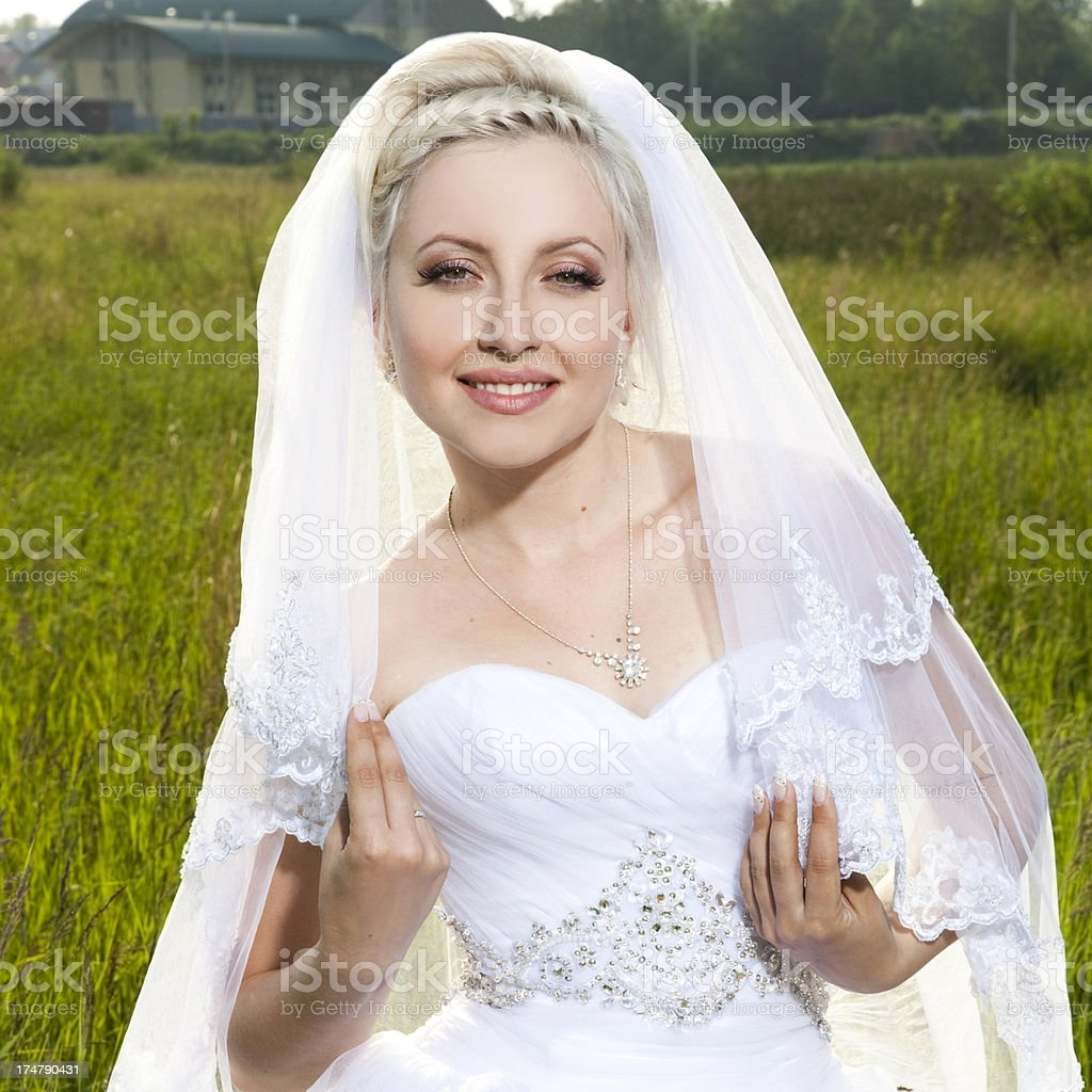 beautiful bride stands  field royalty-free stock photo