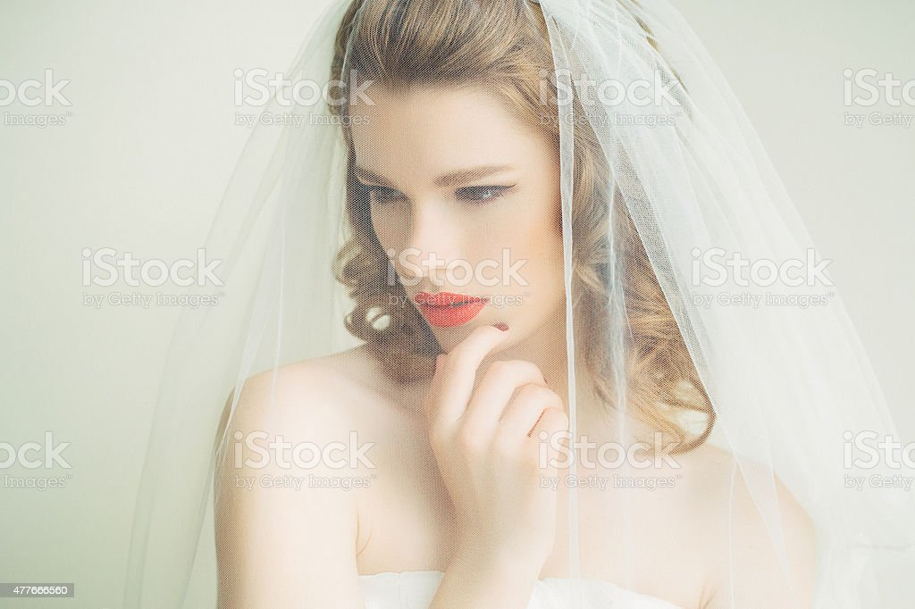 Beautiful bride wearing veil stock photo