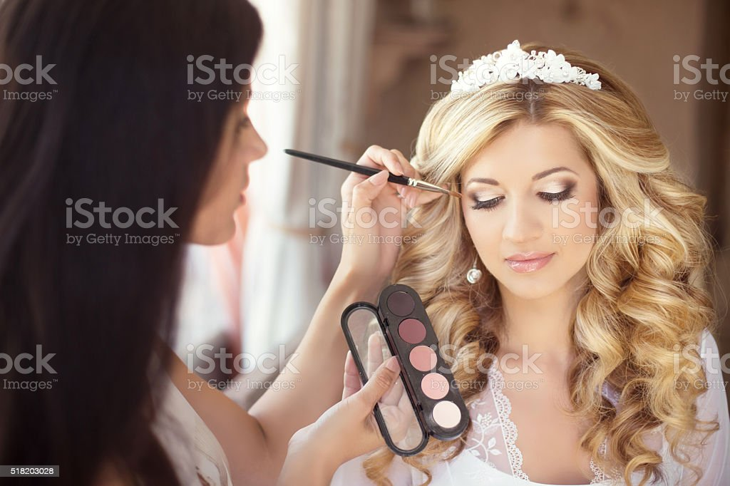 Beautiful bride wedding with makeup and curly hairstyle. Stylist stock photo
