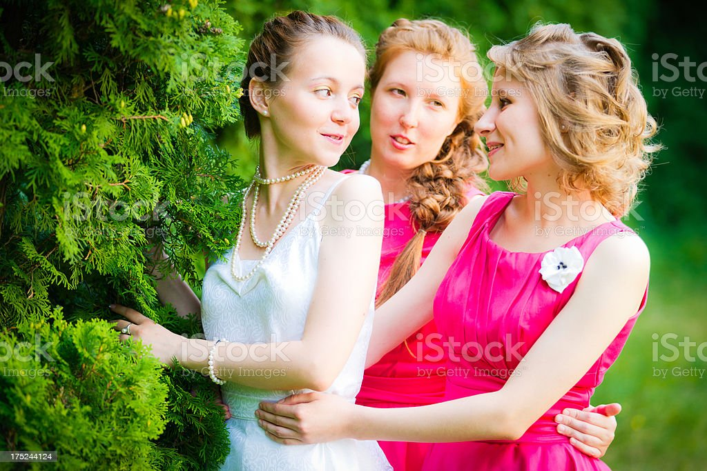 Beautiful bride with her best friends royalty-free stock photo