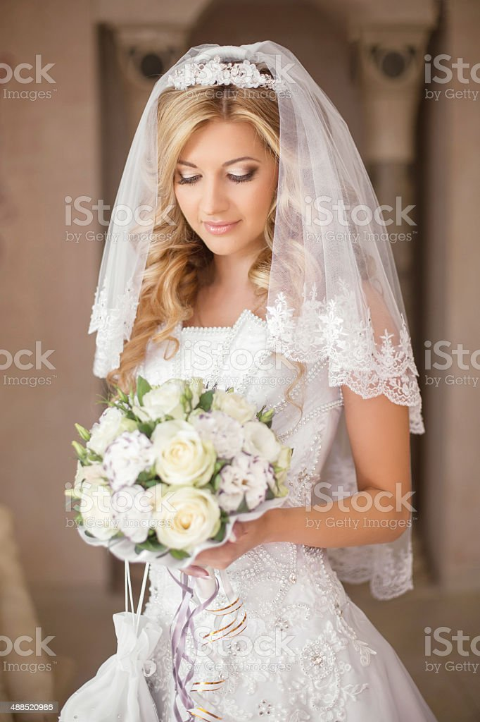 Beautiful bride woman with bouquet of flowers, wedding makeup stock photo