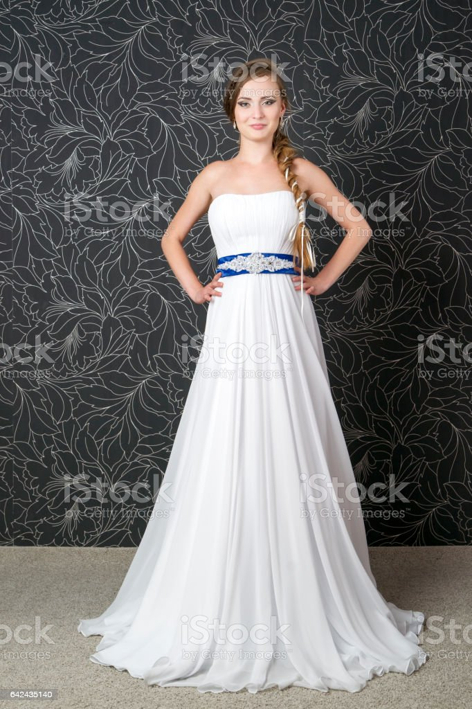 Beautiful bride, young woman in white wedding dress stock photo