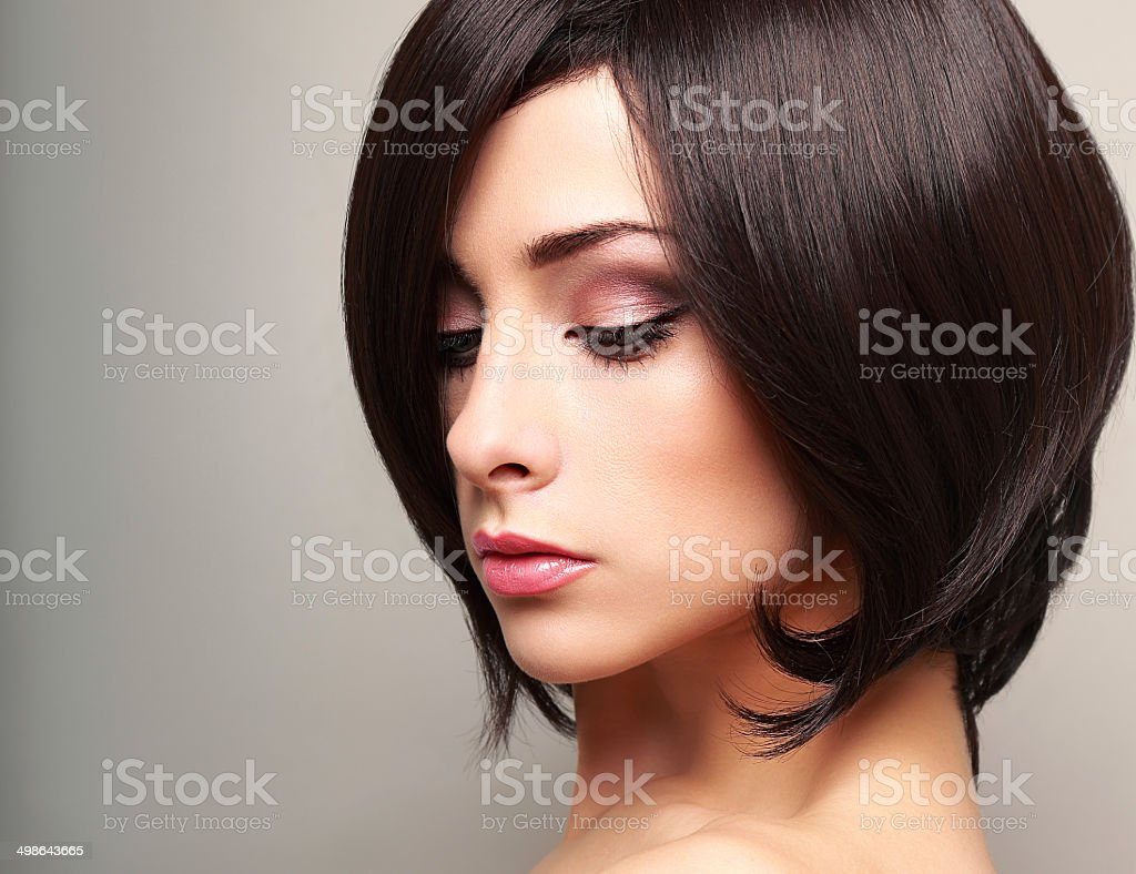 Beautiful bright makeup woman profile with black short hair stock photo