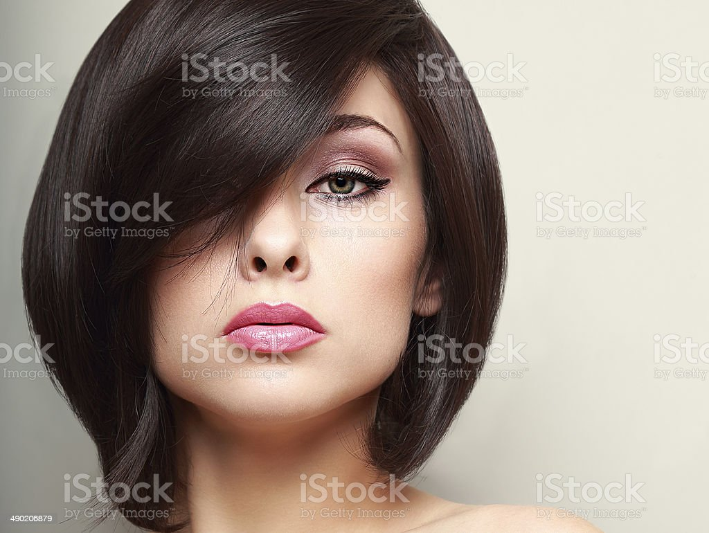 Beautiful bright makeup woman with black short hair style. Closeup stock photo