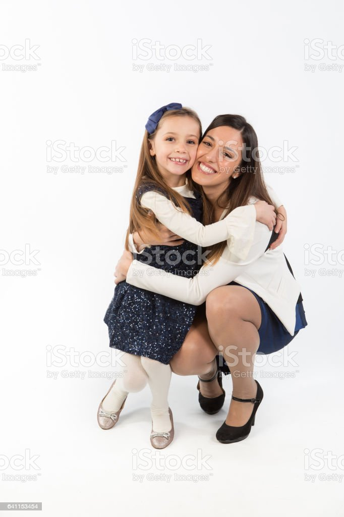 beautiful bright picture of hugging mother and daughter stock photo