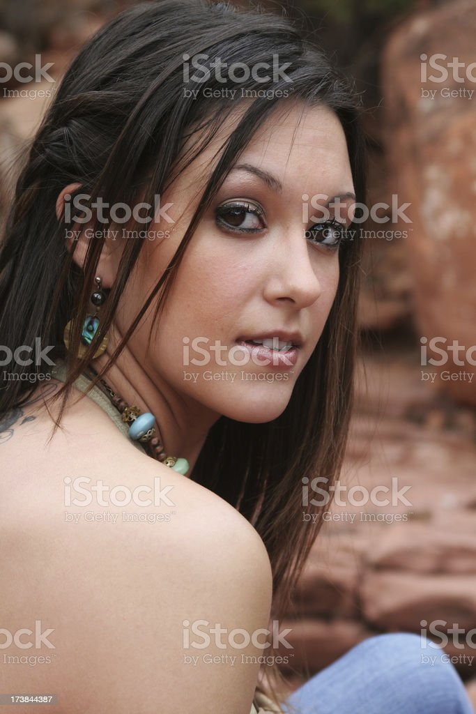Beautiful brown eyed model with bare shoulders stock photo