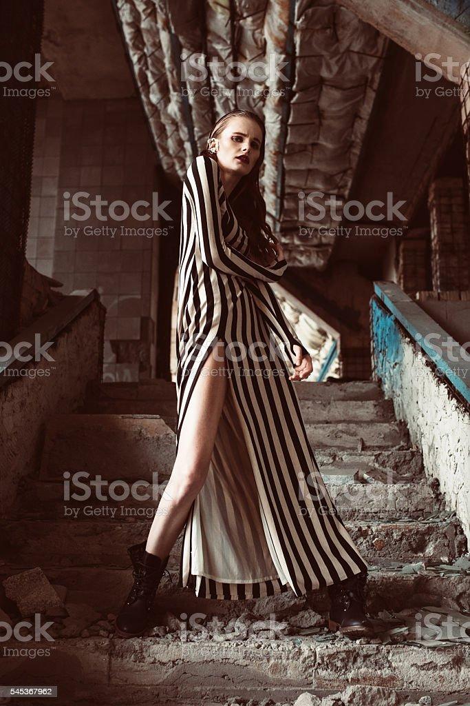 Beautiful brown hair european woman in colorfull elegant dress posing. stock photo
