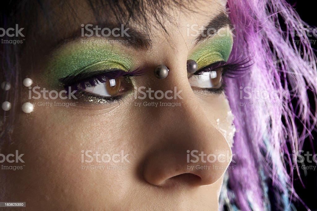 Beautiful brown-eyed model looking away. royalty-free stock photo