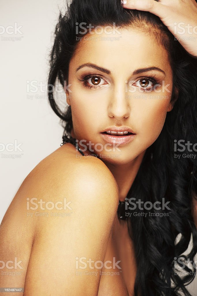 beautiful brunett model in studio on light background royalty-free stock photo
