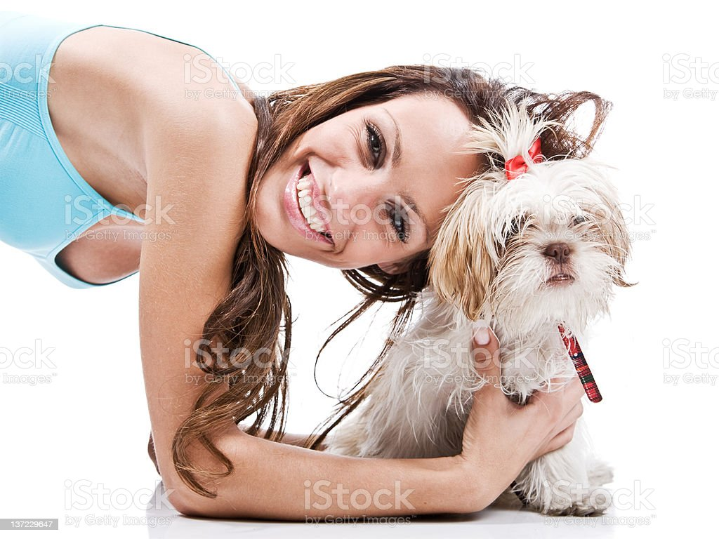 Beautiful brunette and her dog royalty-free stock photo