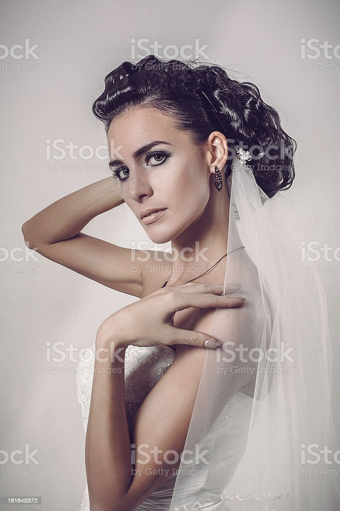 beautiful brunette bride dressed in white dress and veil royalty-free stock photo