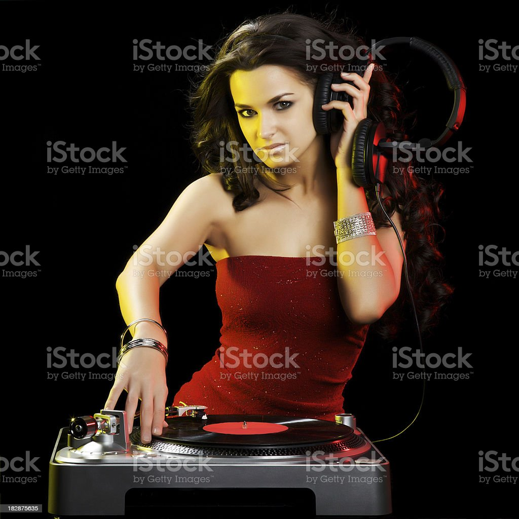Beautiful Brunette DJ With a Turntable stock photo