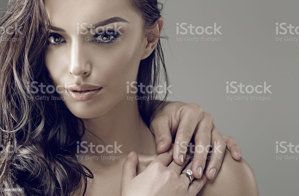 Beautiful brunette engaged female wearing a ring stock photo