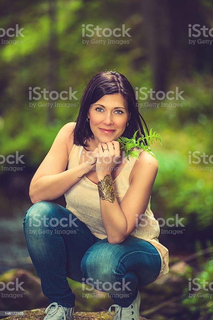 Beautiful brunette enjoying nature royalty-free stock photo