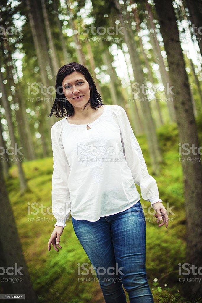 Beautiful brunette enjoying nature stock photo