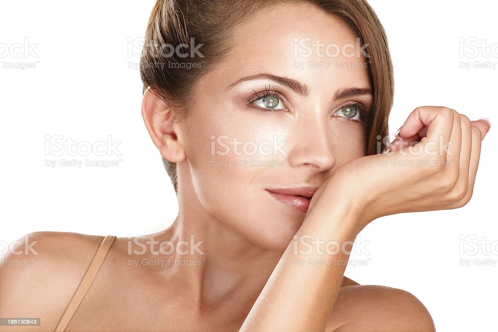 beautiful brunette female model smelling her perfume royalty-free stock photo