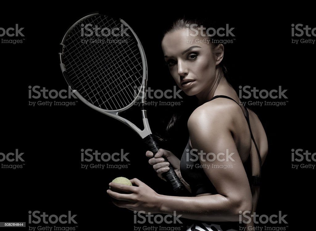 Beautiful brunette female tennis player stock photo
