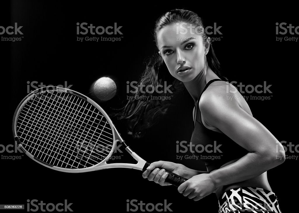 Beautiful brunette female tennis player stock photo
