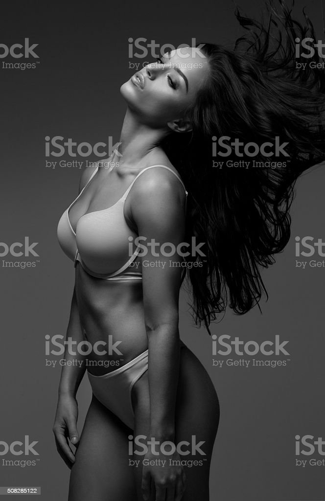 Beautiful brunette female wearing lingerie stock photo