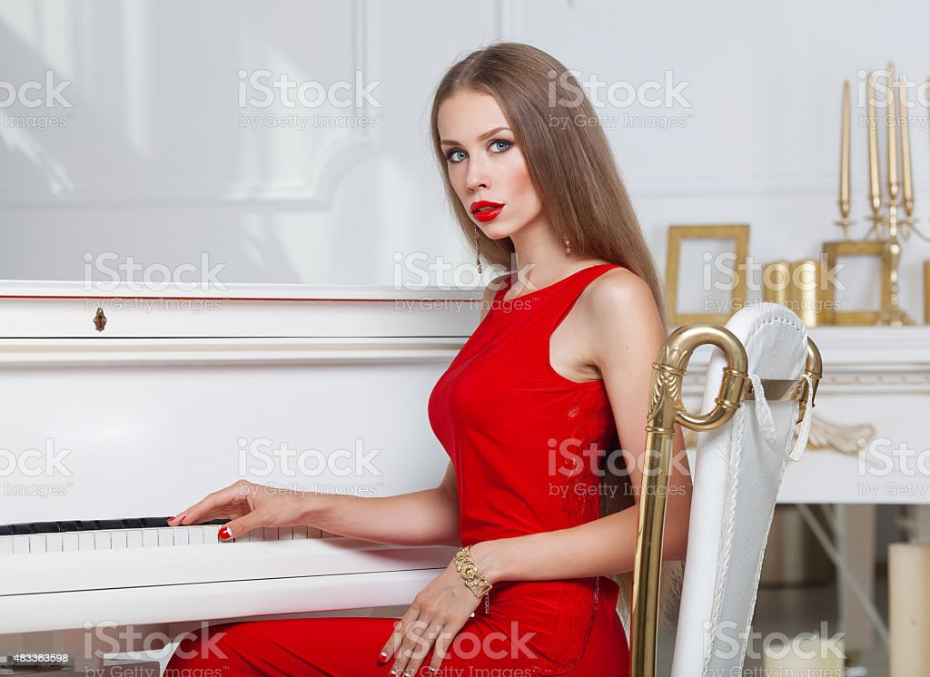 Beautiful brunette girl in a fashionable evening dress. stock photo