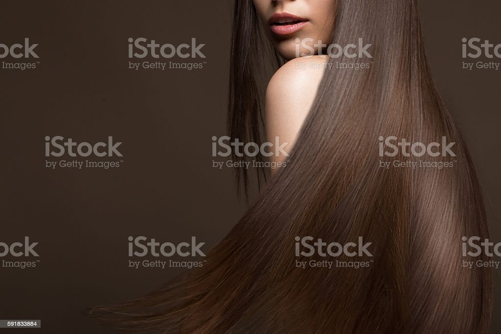 Beautiful brunette girl in move with a perfectly smooth hair royalty-free stock photo