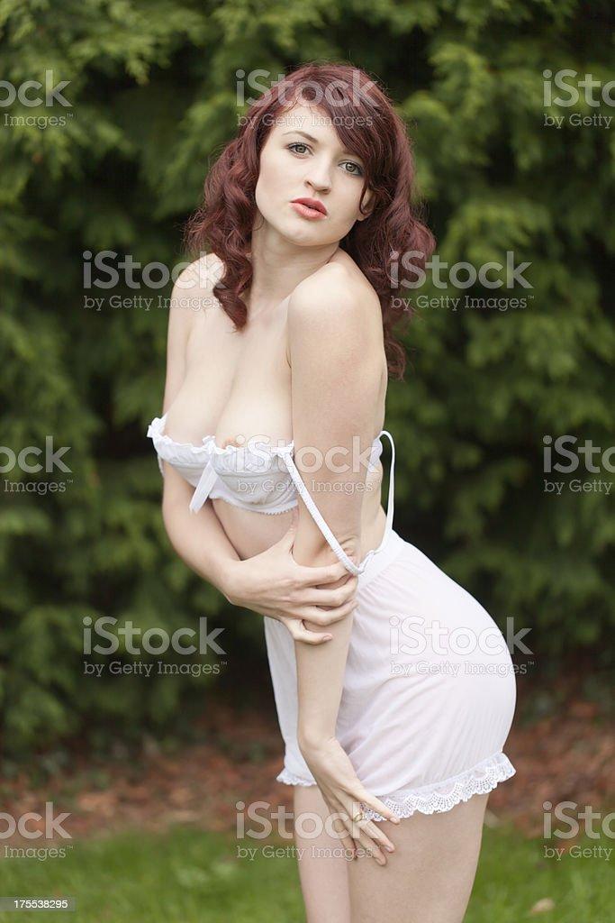 Beautiful brunette girl outdoors stock photo