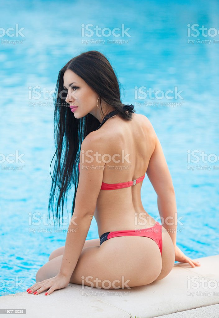 Beautiful brunette girl .Sexy buttocks stock photo