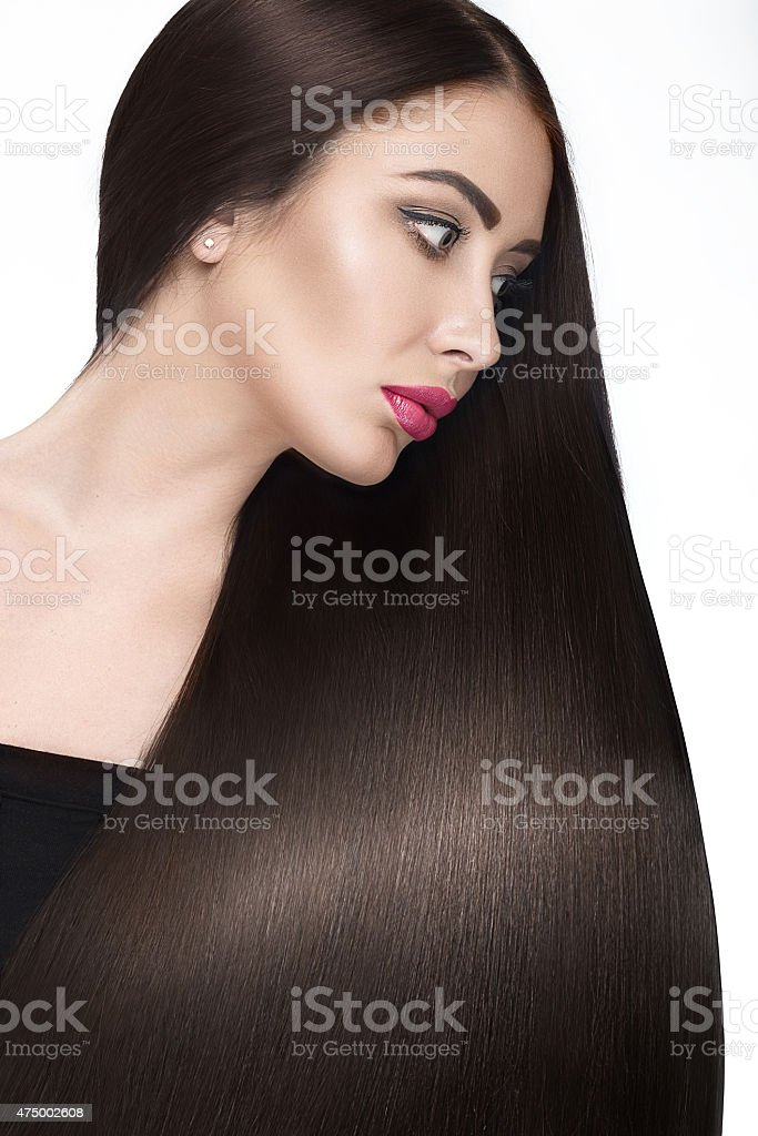 Beautiful brunette girl with a perfectly smooth hair stock photo