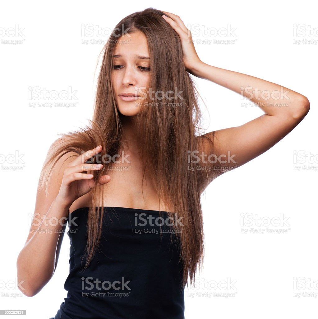 beautiful brunette girl with  braid hairdo looking at splitting ends stock photo