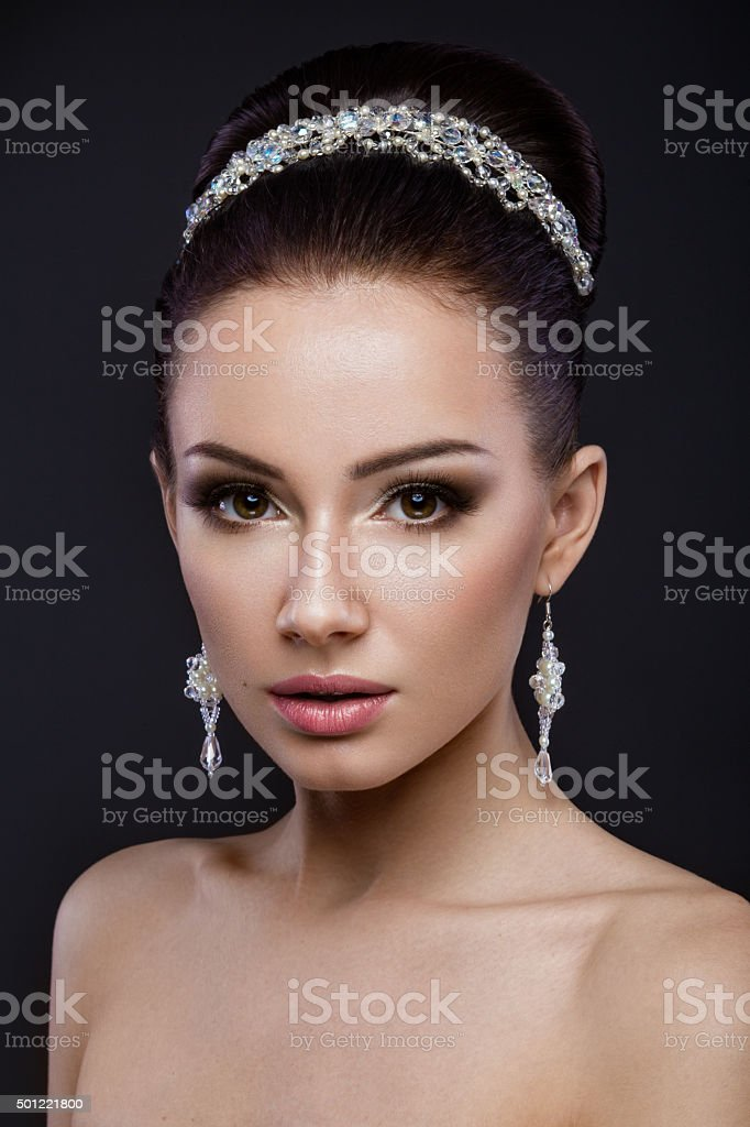 Beautiful brunette girl with perfect skin, evening make-up, wedding stock photo