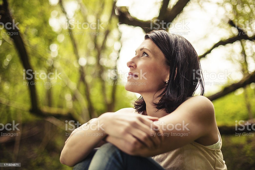 Beautiful brunette in nature stock photo