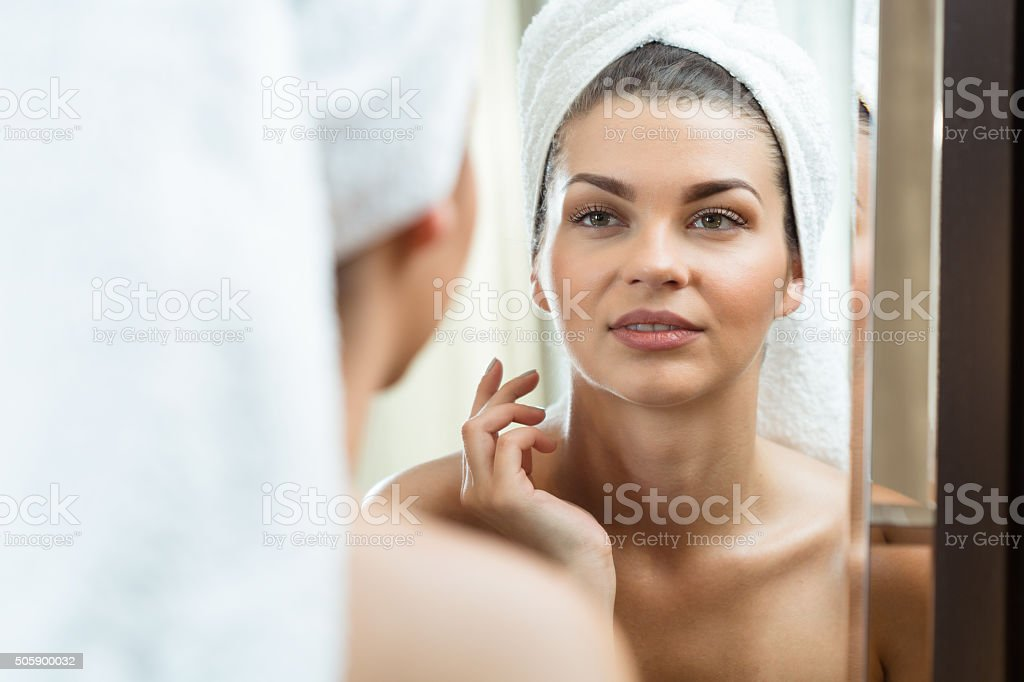 Beautiful brunette in the mirror stock photo