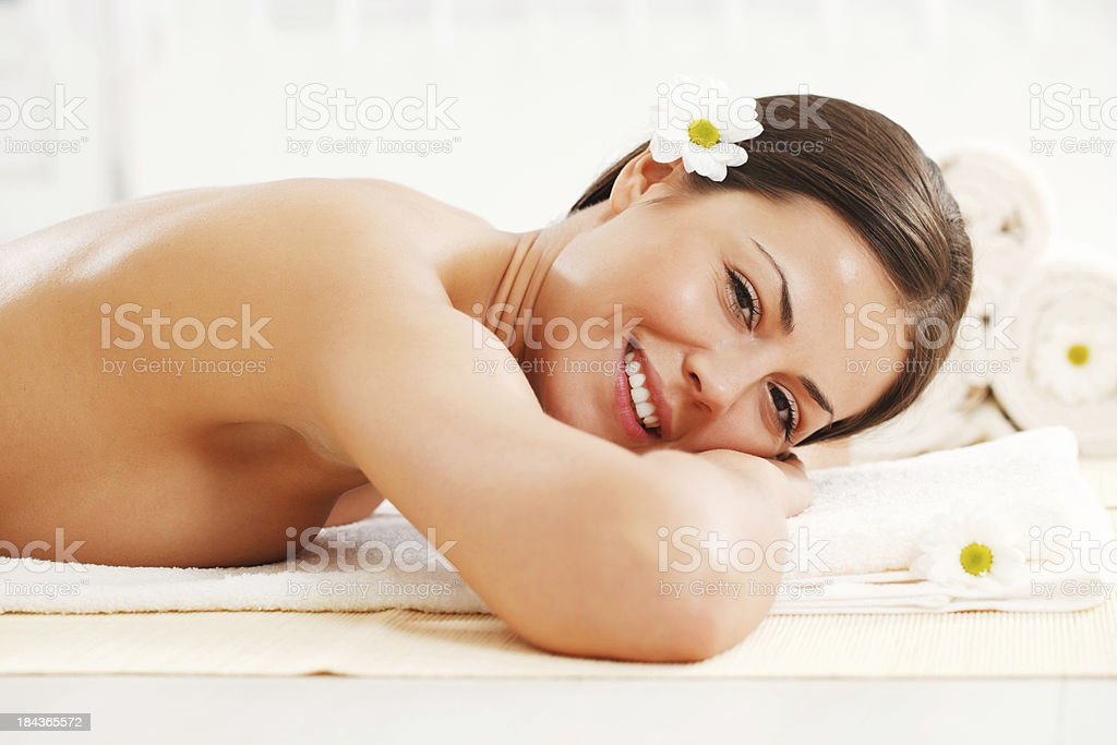 Beautiful brunette is relaxing at the spa royalty-free stock photo
