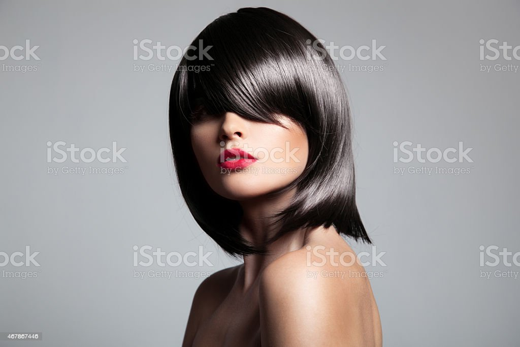 Beautiful brunette model with perfect glossy hair. stock photo