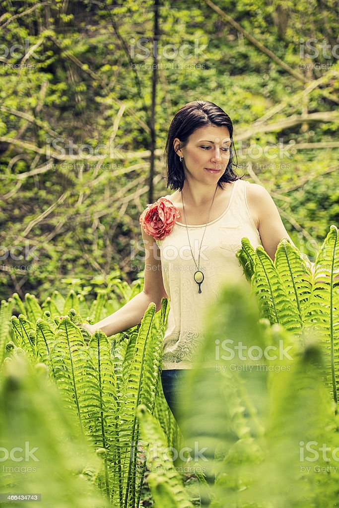 Beautiful brunette outdoors stock photo