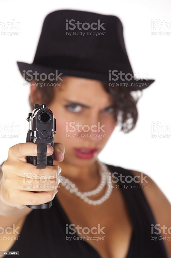Beautiful brunette pointing a gun royalty-free stock photo